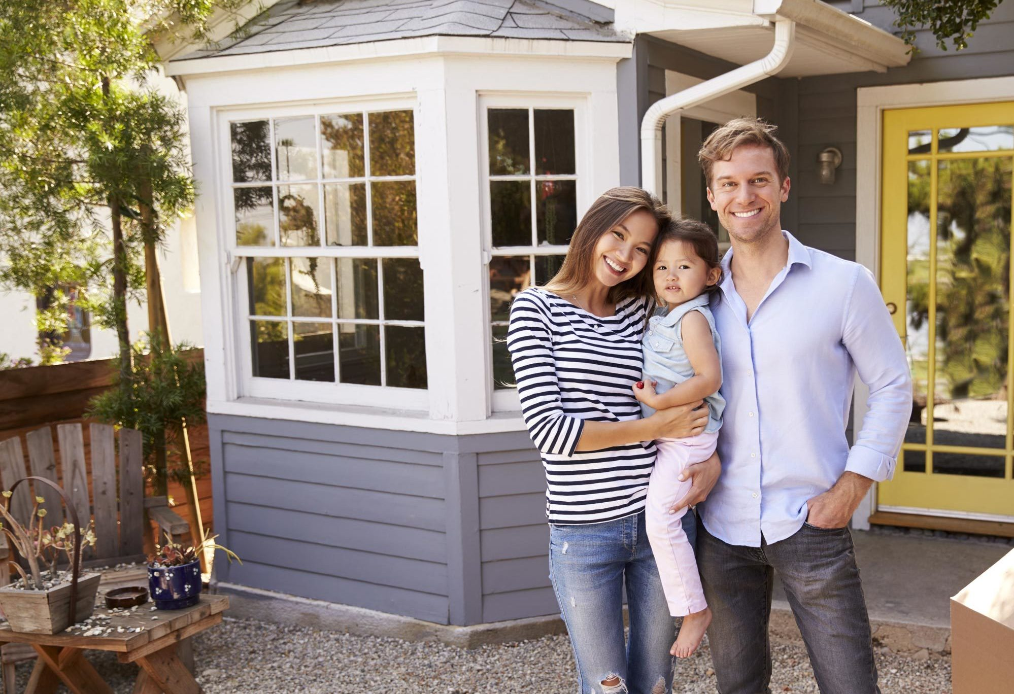 Family outside house with SECURELY® security system