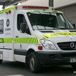 Emergency services ambulance responds to a medical alarm activation
